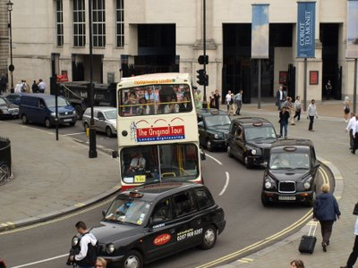 London taxi's passing the plinth, Trafalgar Square, London